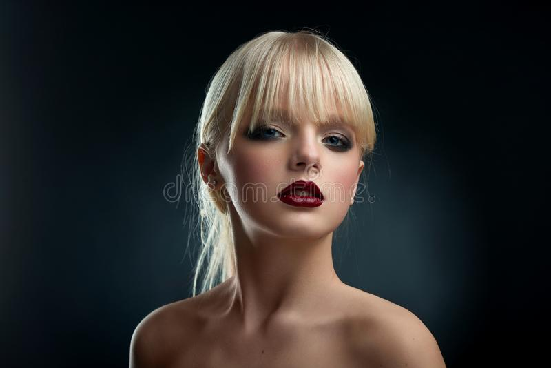 Horizontal frontview of model wearing evening make up. royalty free stock photography