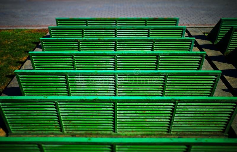 Horizontal green benches object background hd. Orientation vivid vibrant color rich composition design concept element shape backdrop decoration scene wallpaper royalty free stock photo
