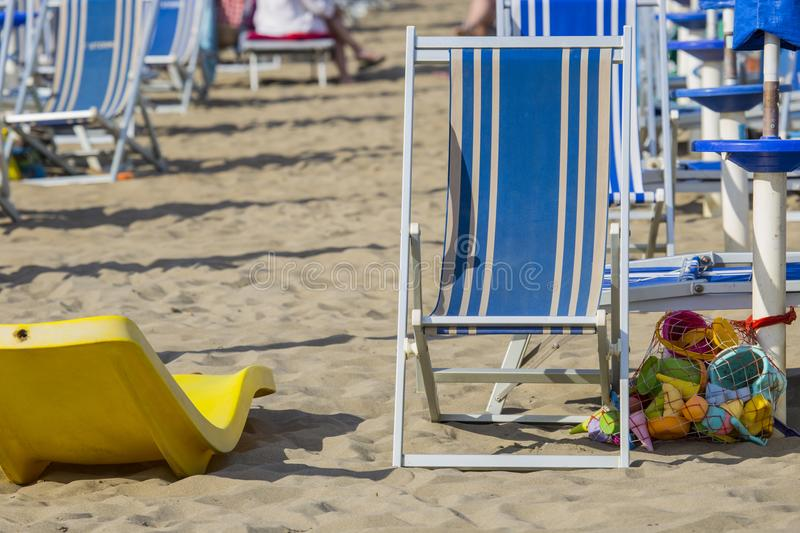 Image of beach chair in blue color in private sand beach stock photography