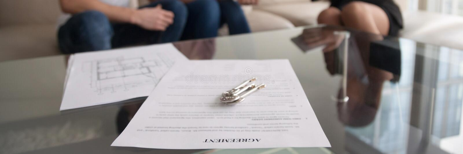 Horizontal image couple meets with realtor for signing rental agreement royalty free stock image