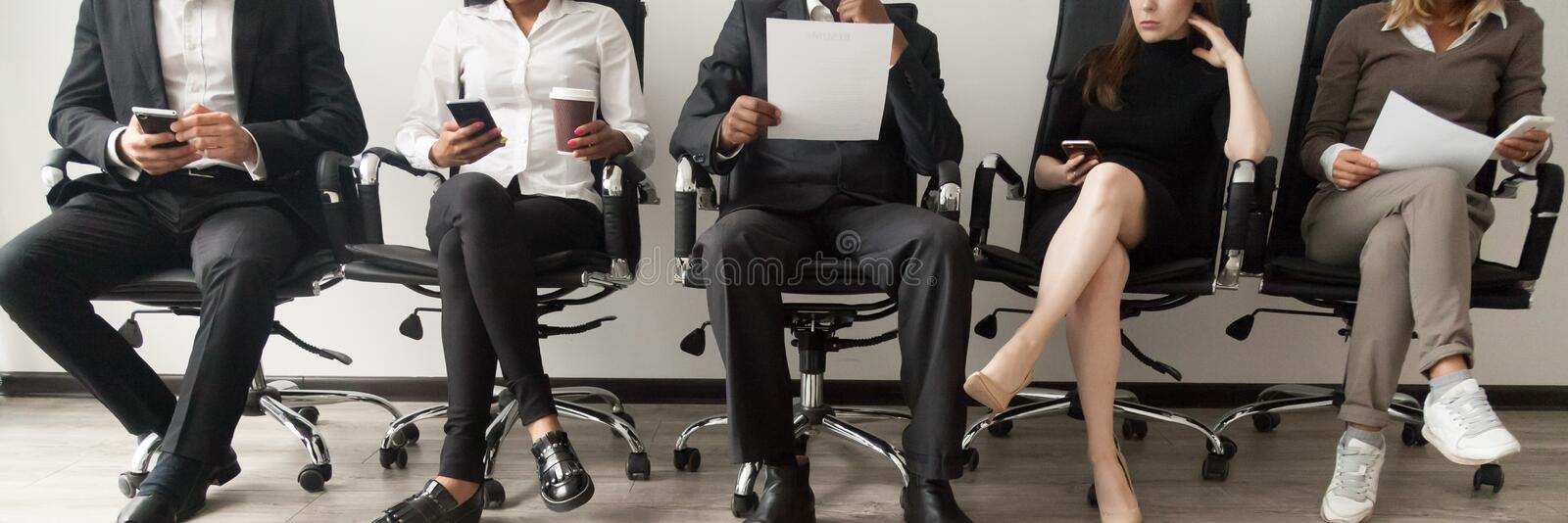 Horizontal image diverse applicants sitting in queue waiting job interview stock photos
