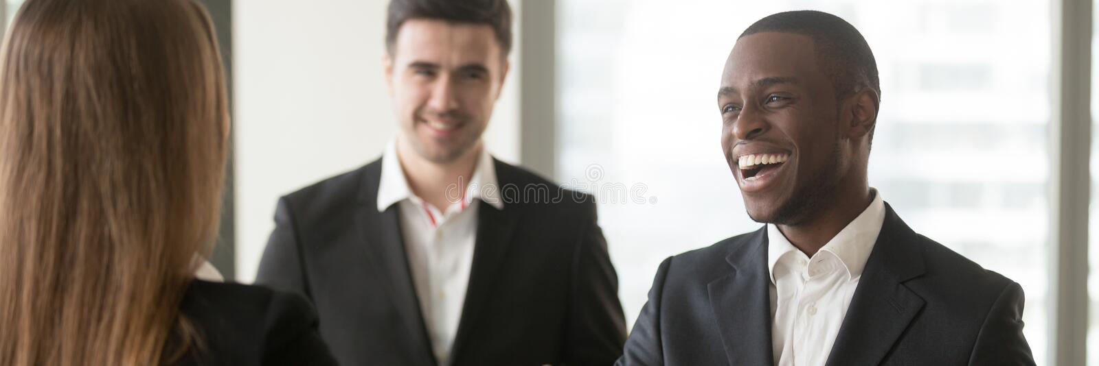 Horizontal image diverse multiracial businesspeople acquainted meet at office stock images