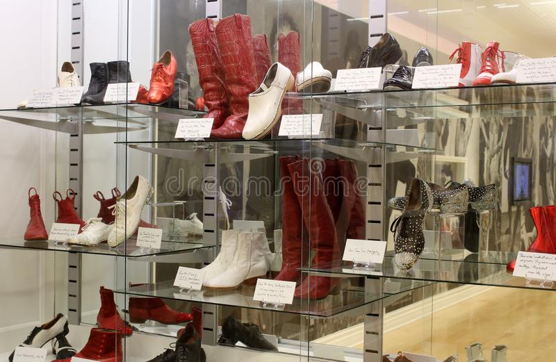 Fun exhibit covering shoes used in dance movies, seen in Hall of Fame, National Museum of dance, Saratoga, 2018. Horizontal image of fun arrangement of shoes stock image