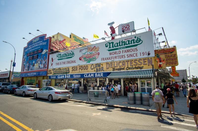 Brooklyn, NY - Landscape view of the iconic Nathan`s located in the Coney Island section of New York City. royalty free stock photography