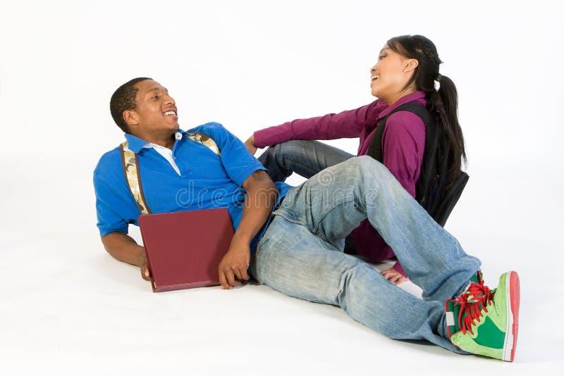 horizontal laughing seated students στοκ φωτογραφία με δικαίωμα ελεύθερης χρήσης