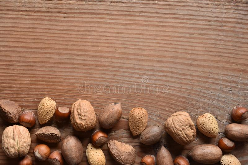 Mixed nuts with copy space on wood stock photos
