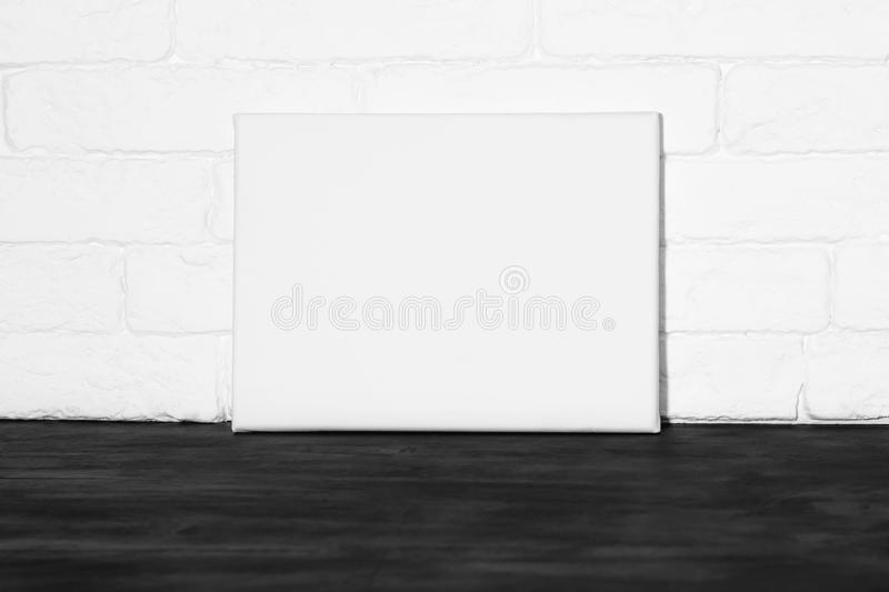 Mockup poster in interior. Horizontal mock-up poster. White canvas in interior royalty free stock photography