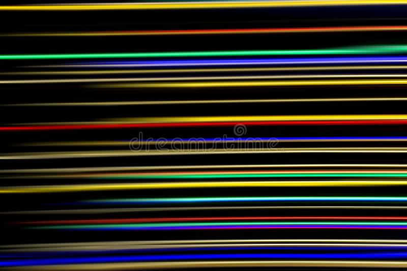 Horizontal multicolor light rays on a black background. Long exposure photo. Abstract, speed, fast, movement, texture, design, bright, art, colorful, wallpaper stock image
