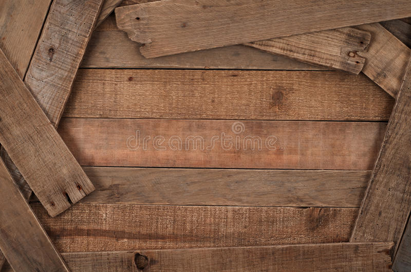 Rustic, Country Style Wood Slat Background. Horizontal overview of wood slats arranged in a casual manner with some used as framing for the center boards royalty free stock photo