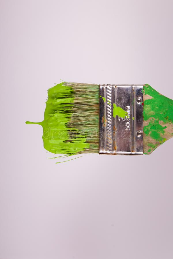 Horizontal paintbrush lime green wet paint dripping horizontally stock image