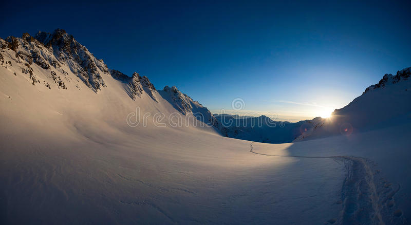 Horizontal panorama of snow-covered glacier and mountain peaks of Kyrgyzstan stock photo
