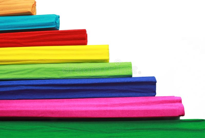 Horizontal pattern with colorful crepe paper rolls. In front of a white background royalty free stock photography