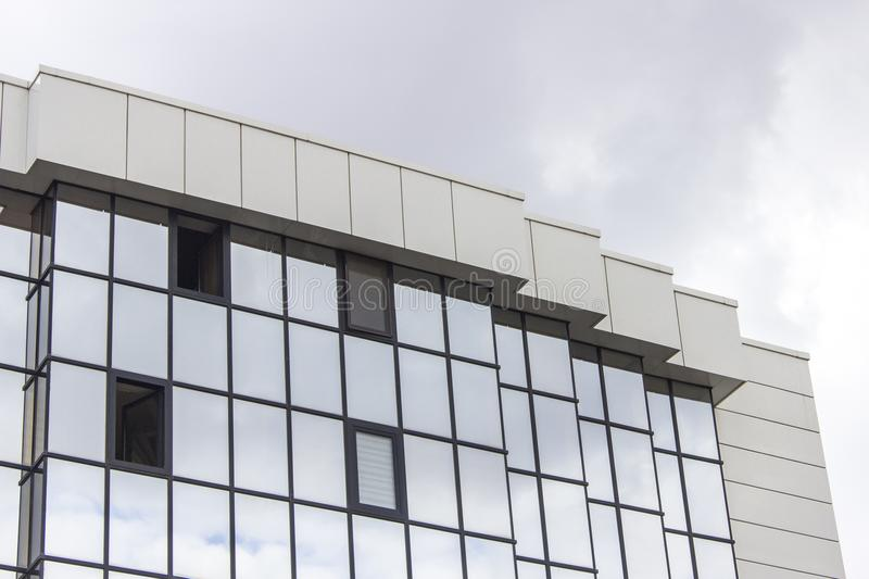 Horizontal perspective shot of multiple floor of a glazing facade building with overcast sky in Ankara at Turkey stock photo