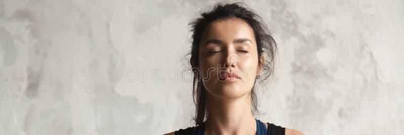Horizontal image beautiful woman face with closed eyes practicing yoga. Horizontal photo beautiful woman face with closed eyes practicing yoga breath meditate stock photography