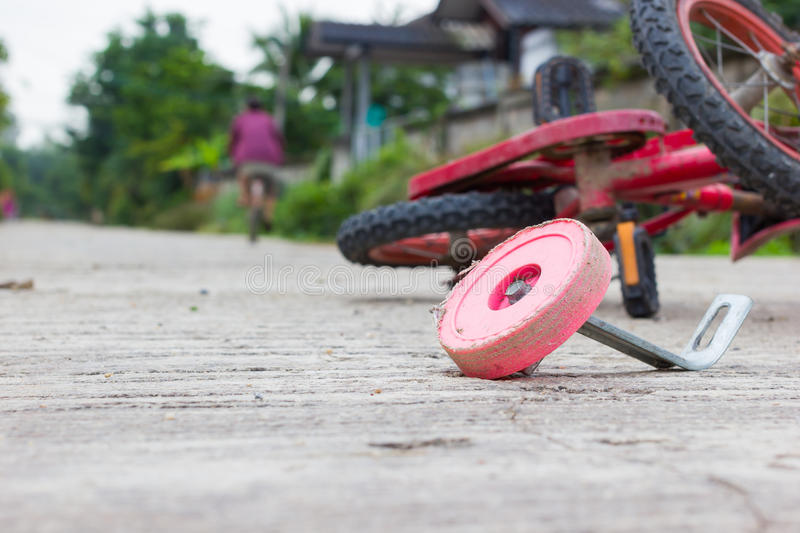 Horizontal photo of closeup bicycle for children accident on the. City street royalty free stock image