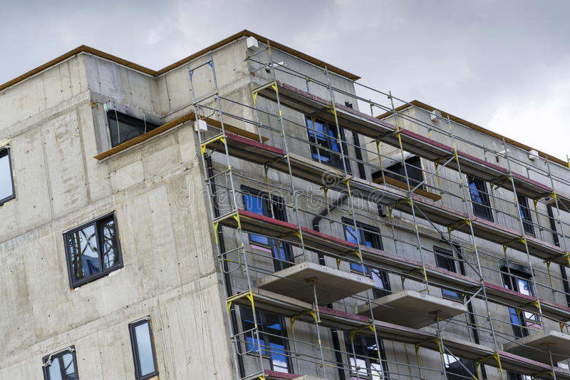 Horizontal photo of house apartment construction site. With scaffolding royalty free stock photo