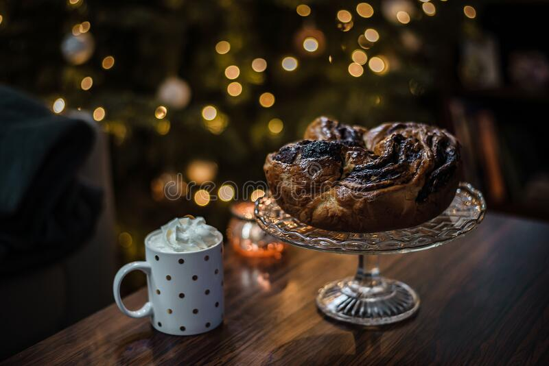 Horizontal photo od a cozy idea for Christmas breakfast consisting of home made chocolate wreath and hot cocoa. royalty free stock image
