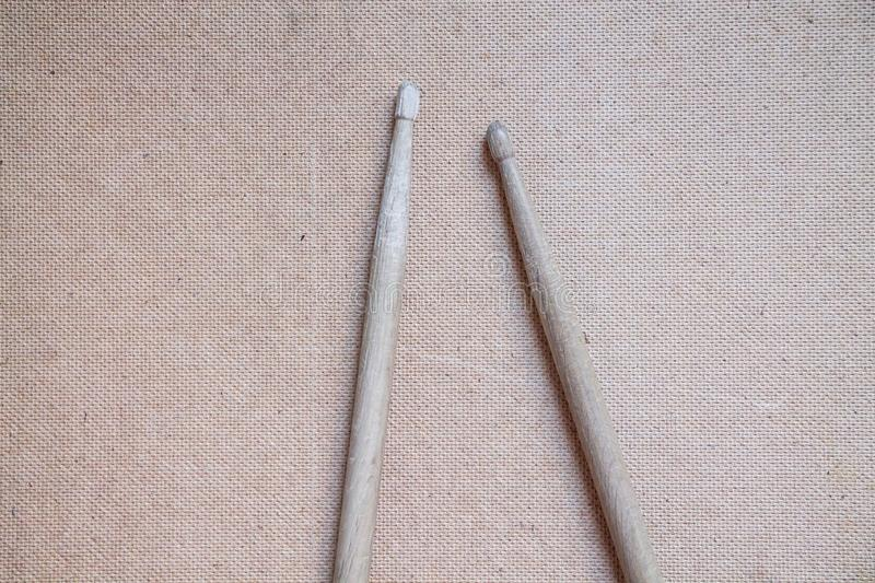 Horizontal photo of old used drumsticks on a light background stock photography