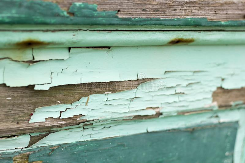 Horizontal photo of old wood with chipped peeling teal paint royalty free stock images