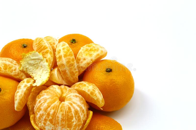 Ripe, juicy, fresh tangerines in peel and without peel on white background stock photo