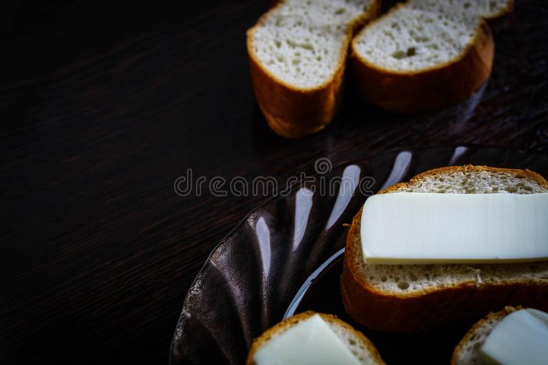 Fresh sandwiches with melted cheese in a glass plate stock photos