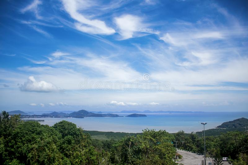 View from Khao-Khad Views Tower looking northeast to Andaman Sea, Ko Sire island, mountains. With interesting blue sky. Horizontal photo of the view from Khao stock photo