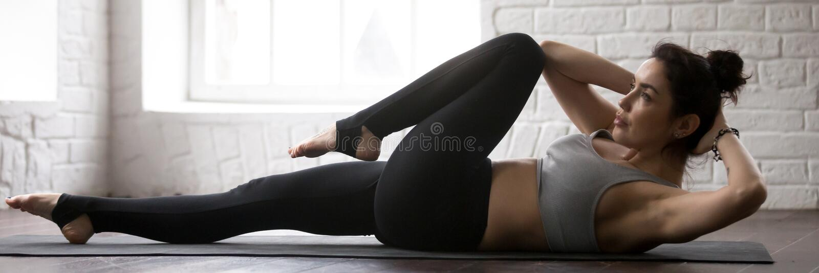 Horizontal image beautiful female doing bicycle crunches crisscross fitness exercise stock photos