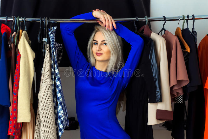 Horizontal portrait of beautiful young blond woman in a clothing stock photography