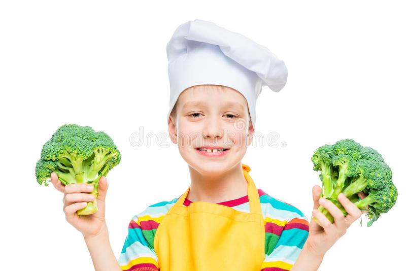 horizontal portrait of a boy in a cook hat with broccoli on a white royalty free stock image