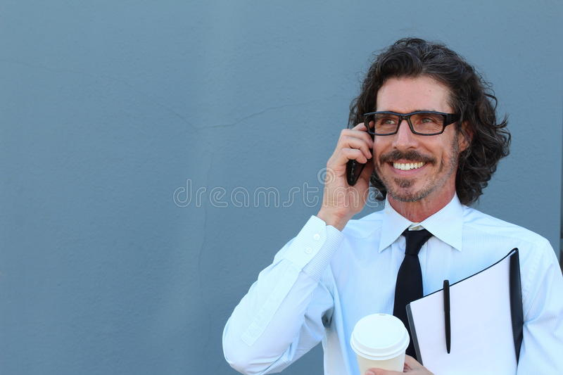 Horizontal portrait of a Caucasian middle-aged handsome man wearing a shirt and tie while having a pleasant conversation royalty free stock photography
