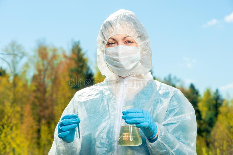 horizontal portrait of a chemist-researcher of a lake`s water composition royalty free stock photos