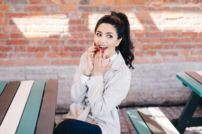 Horizontal portrait of happy female with dark hair and beautiful royalty free stock photos