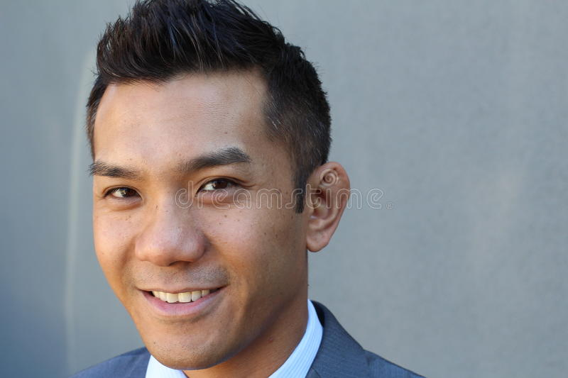 Horizontal portrait of a natural handsome classic Asian male with copy space on the right royalty free stock photos
