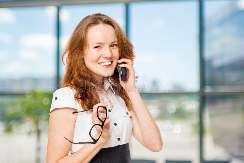 Horizontal portrait of an office worker with a phone royalty free stock images
