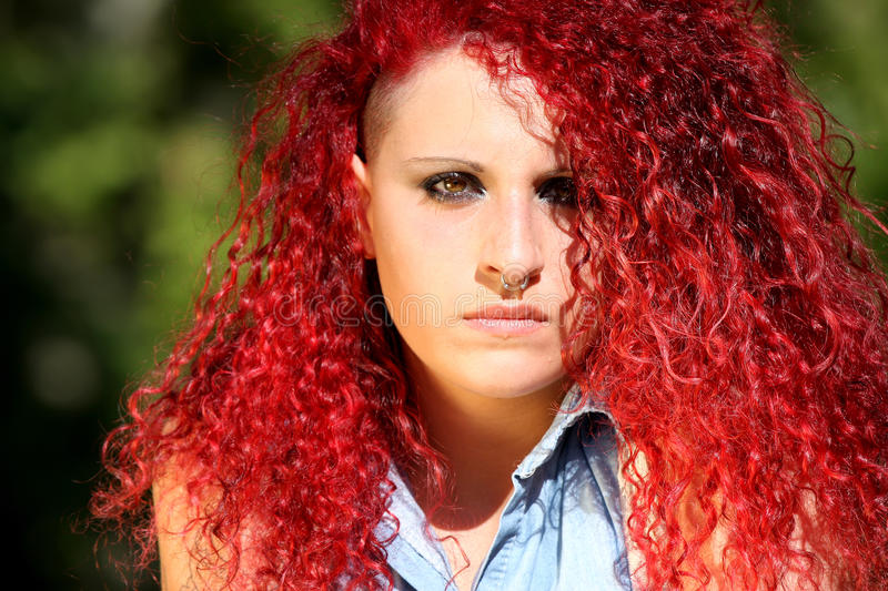 Horizontal portrait of a young girl with red curly hair stock photo