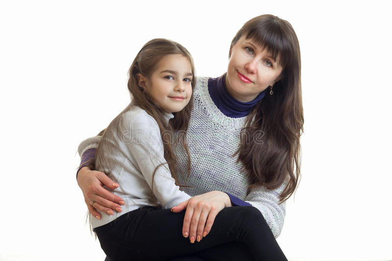 Horizontal portrait of a young mother with her cute daughter isolated on a white background stock photos