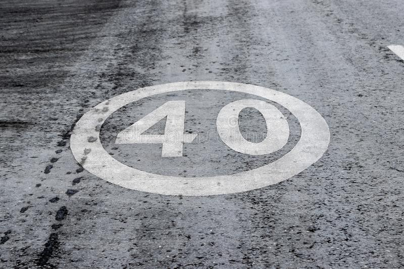 Horizontal road surface marking `Speed limit 40` royalty free stock images