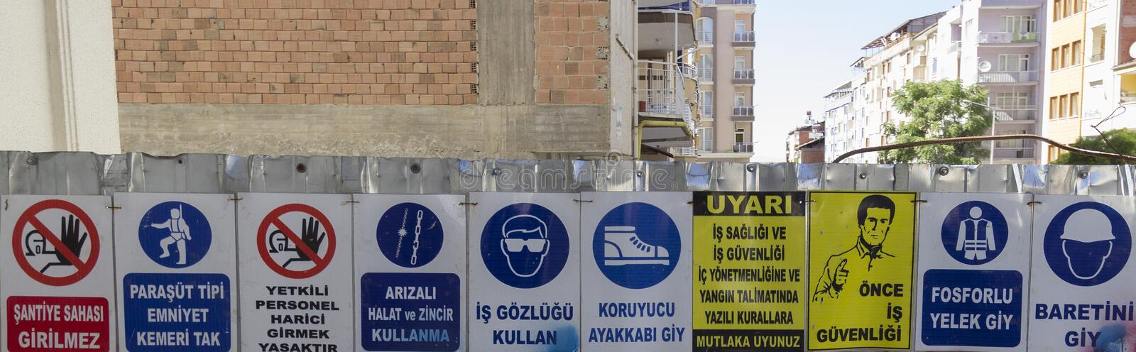 Horizontal Series of Work Safety Signs at a construction site royalty free stock image
