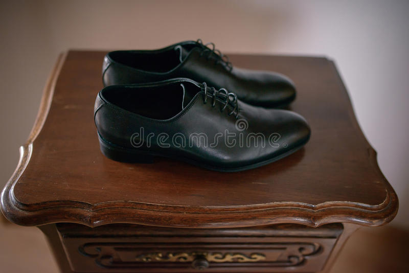 Horizontal shot of black, leather male pair of shoes stock image