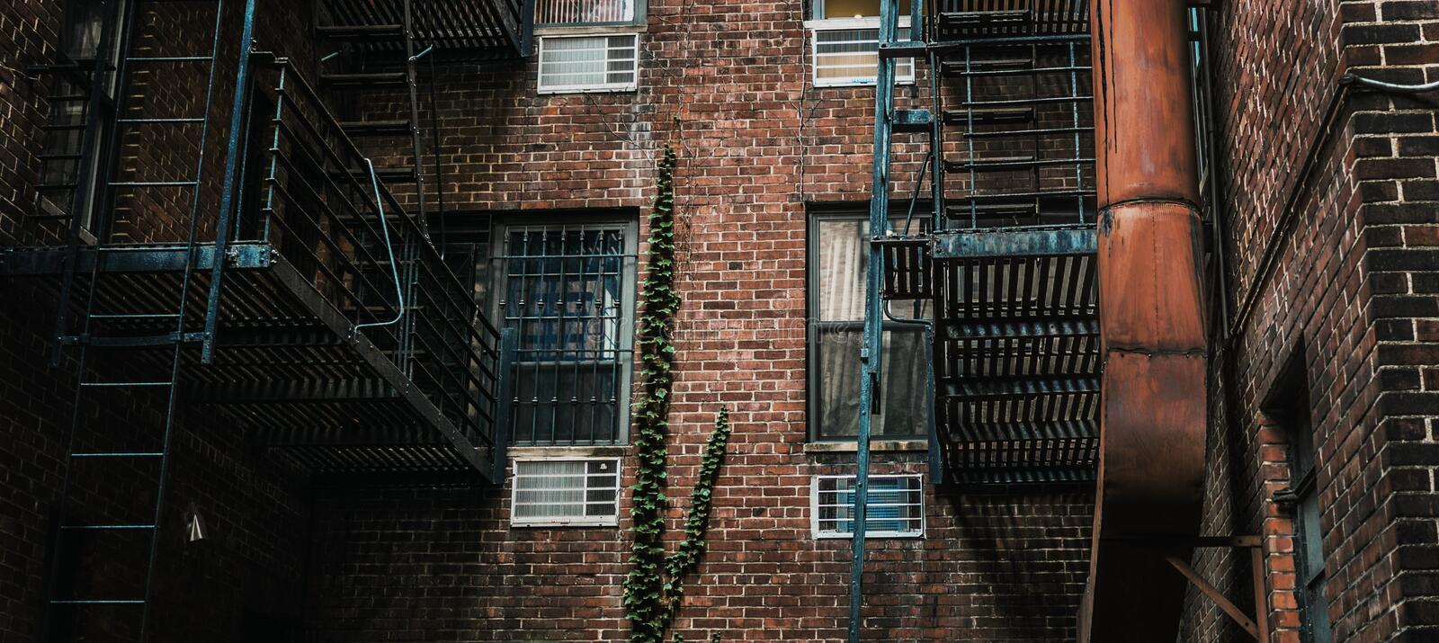 Horizontal shot of fire escape stairs on a brick building. A horizontal shot of fire escape stairs on a brick building stock image
