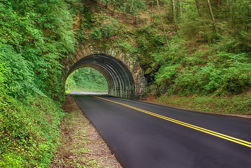 New Blacktop Road Through Smoky Mountains. Horizontal shot of a new blacktop road going through a tunnel in the Smoky Mountains National Park in Tennessee stock image