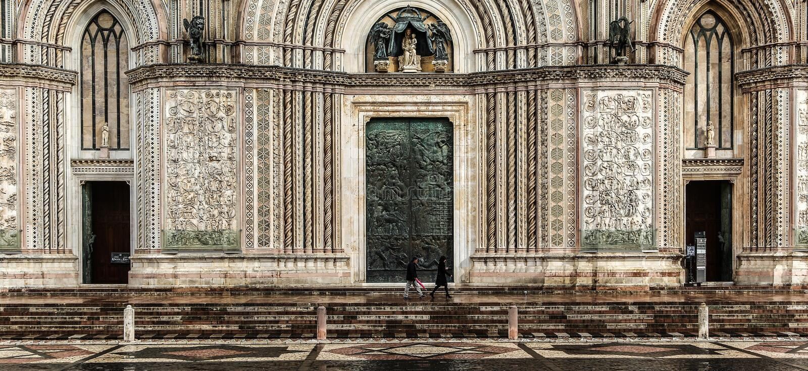 Horizontal shot of people walking in front of the Orvieto Cathedral in Italy during daytime. A horizontal shot of people walking in front of the Orvieto royalty free stock photos