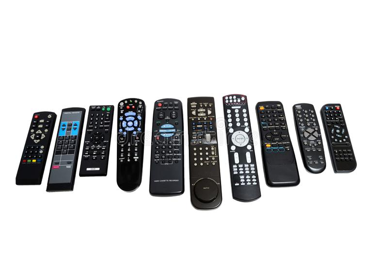 Many Old Worn-Out Remote Controls Shot On Angle stock image