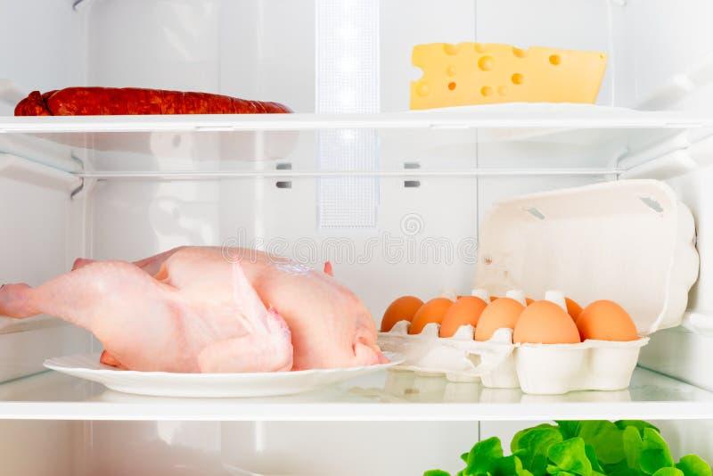 Horizontal shot shelves of the refrigerator with food. Horizontal shot shelves of the refrigerator with fresh food royalty free stock image