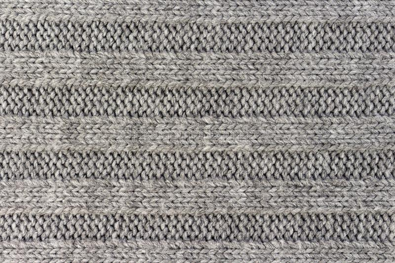Horizontal striped gray knitting fabric texture, knitted pattern background stock images