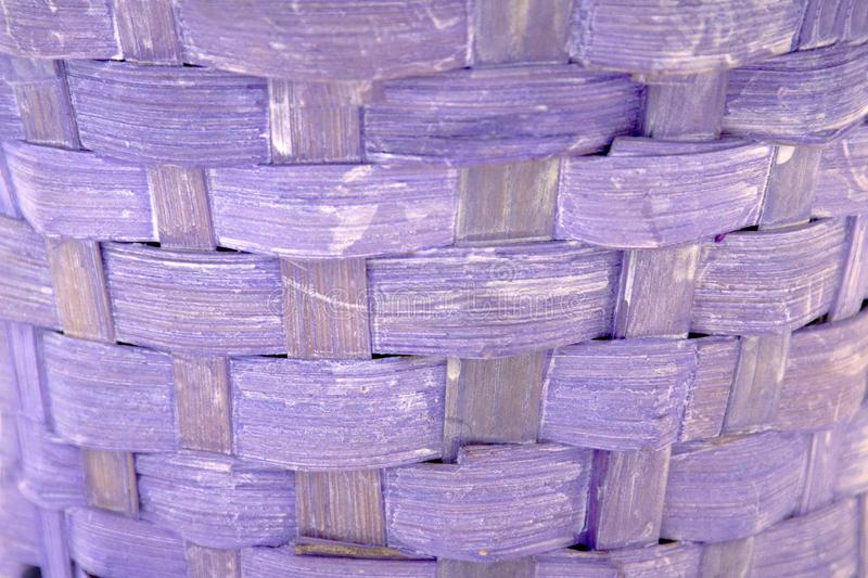 Horizontal texture of decorative lilac wicker wooden basket. Violet background with retro effect stock photography