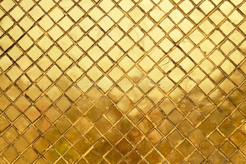 Horizontal Texture of Golden Mosaic Wall Background stock images