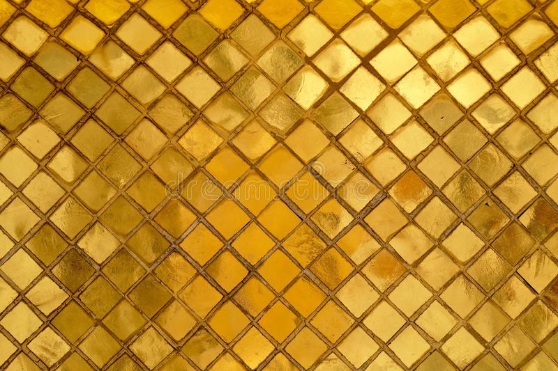 Horizontal Texture of Golden Mosaic Wall Background stock photography