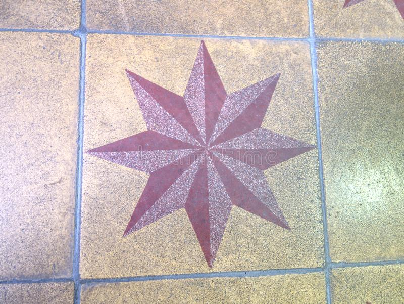 Horizontal tiled floor in old burgher house in detail. Tiles red and white stars, symbol, style, stone, steel, square, shower, reflection, pool, pattern royalty free stock image