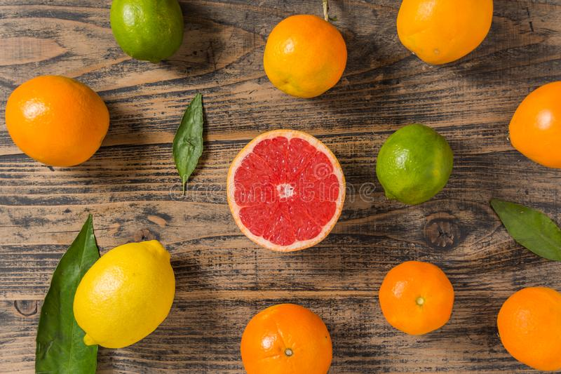 Lot of citrus fruits on black wooden background royalty free stock photography